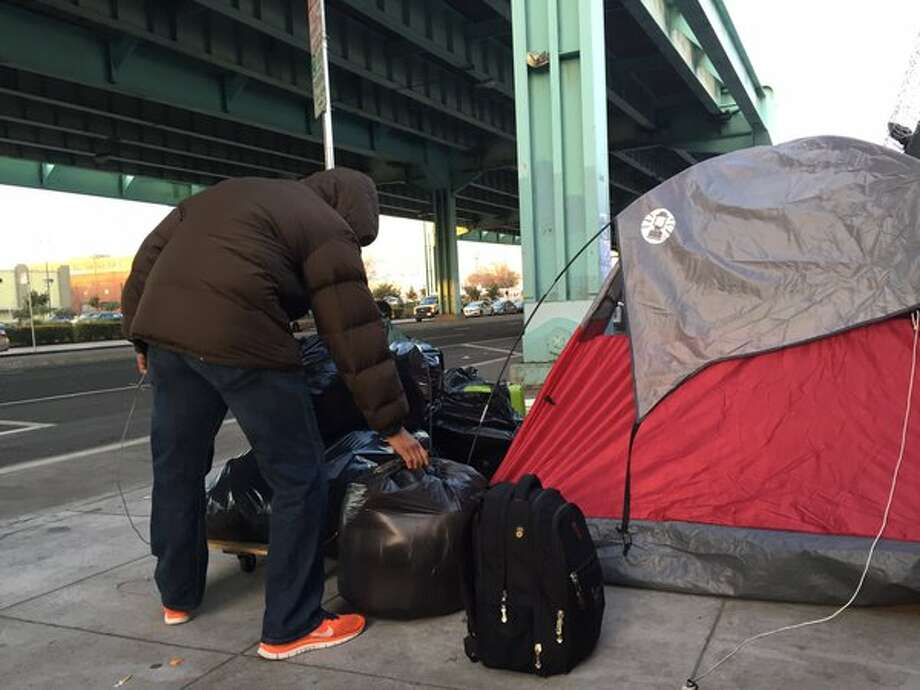 Jose Navarro plans to try to get into the city's Navigation Center as crews sweep Division of homeless camps. Photo: Kale Williams/The Chronicle