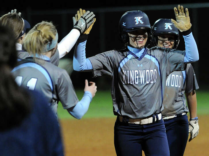 Kingwood second baseman Lacy Gregory celebrates her game-winning RBI single with teammates during the seventh inning of a high school softball game against Klein Collins. (Photo: Eric Christian Smith/For the Chronicle)