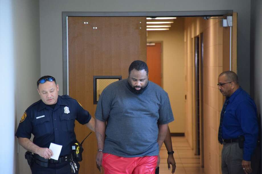Police arrest and transport R.C. Curtis on March 1, 2016. Curtis is suspected of killing and robbing Paula Boyd, 75, in 2015. Photo: By Mark D. Wilson/San Antonio Express-News