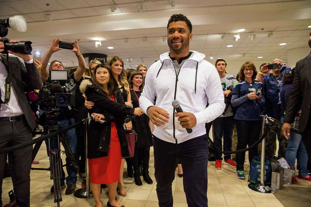 """Seattle Seahawks quarterback Russell Wilson greets fans at Nordstrom on February 29, 2016 in Seattle, Washington, for the launch of his """"Good Man Brand"""" clothing line."""