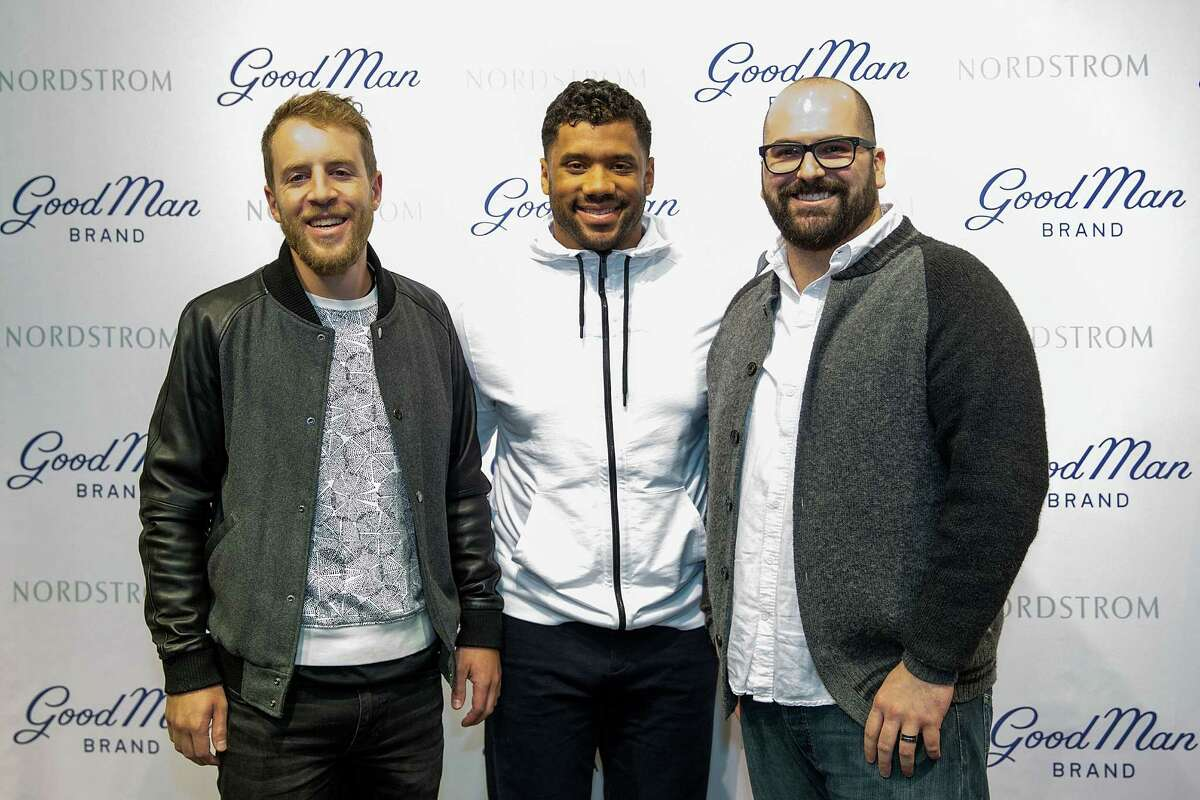 Seattle Seahawks quarterback Russell Wilson poses with fans at Nordstrom on February 29, 2016 in Seattle, Washington.