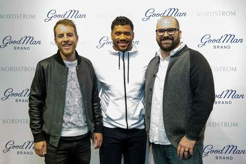 9bf3ea3dfca Seattle Seahawks quarterback Russell Wilson poses with fans at Nordstrom on February  29