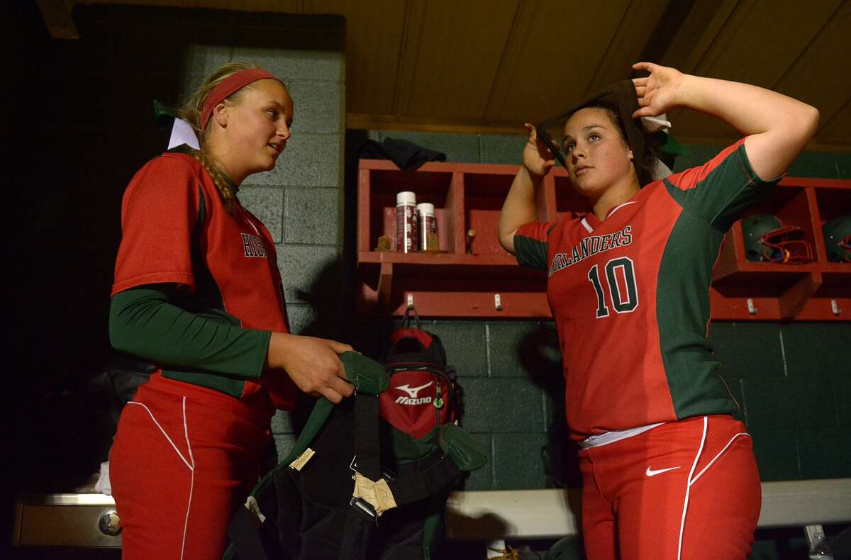 The Woodlands junior pitcher Emily Langkamp, left, and junior catcher Kelcy Leach get ready to go to work against Bellaire during their match up at The Woodlands Varsity Round Robin Invitational last weekend.