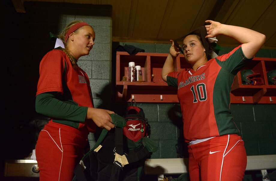 The Woodlands junior pitcher Emily Langkamp, left, and junior catcher Kelcy Leach get ready to go to work against Bellaire during their match up at The Woodlands Varsity Round Robin Invitational last weekend. Photo: Jerry Baker, Freelance