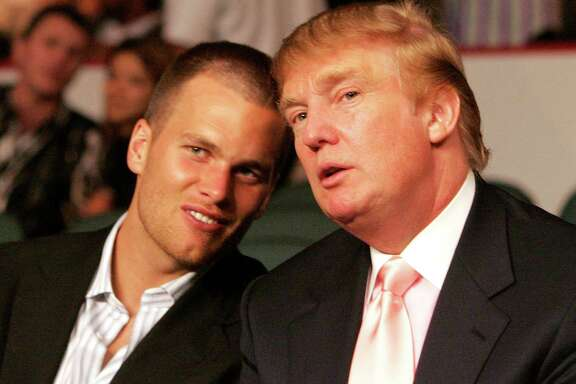 New England Patriots quarterback Tom Brady chats with Donald Trump (Photo by Donna Connor/WireImage)