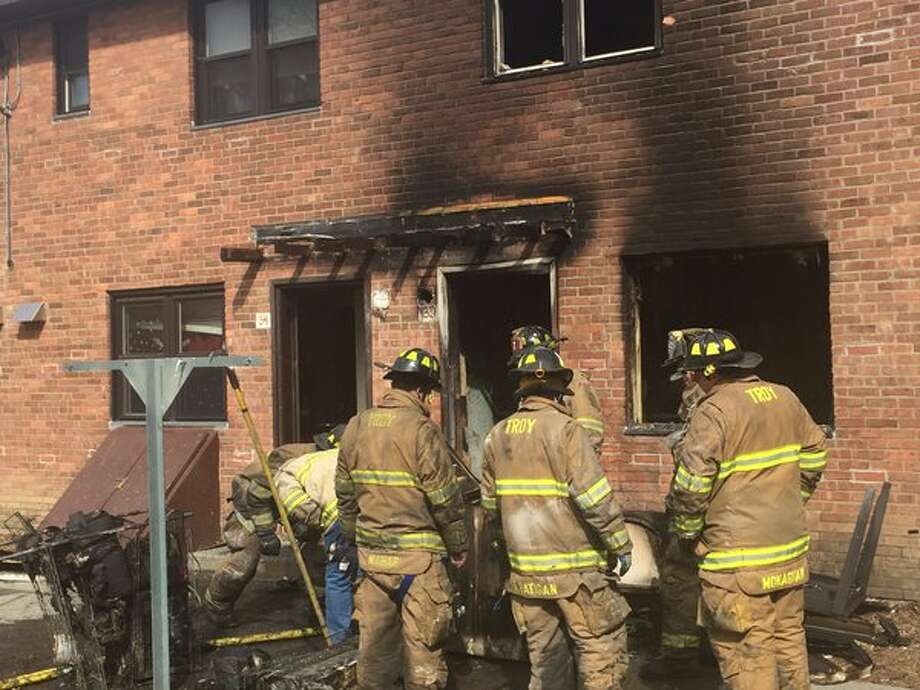 Three apartments were damaged when fire broke out at the Griswold Heights apartment complex on Tuesday. No one injured by the flames and city officials said residents displaced by the blaze were being moved to other apartments. (Kenneth C. Crowe II / Times Union)