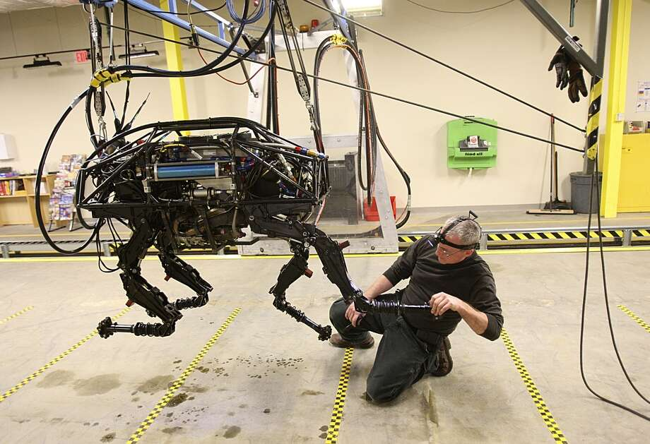 WALTHAM, MA - FEBRUARY 3: A BigDog robot at Boston Dynamics. Innovation Economy column on local robotics company called Boston Dynamics, which mainly does military contracting work - they just won a big contract this week from the Department of Defense. One of their robots, called BigDog, is being developed to help soldiers carry heavy equipment in the field -- it can literally follow a human being, walking across wet/sandy/rocky terrain, just like a dog would. (Photo by Suzanne Kreiter/The Boston Globe via Getty Images)