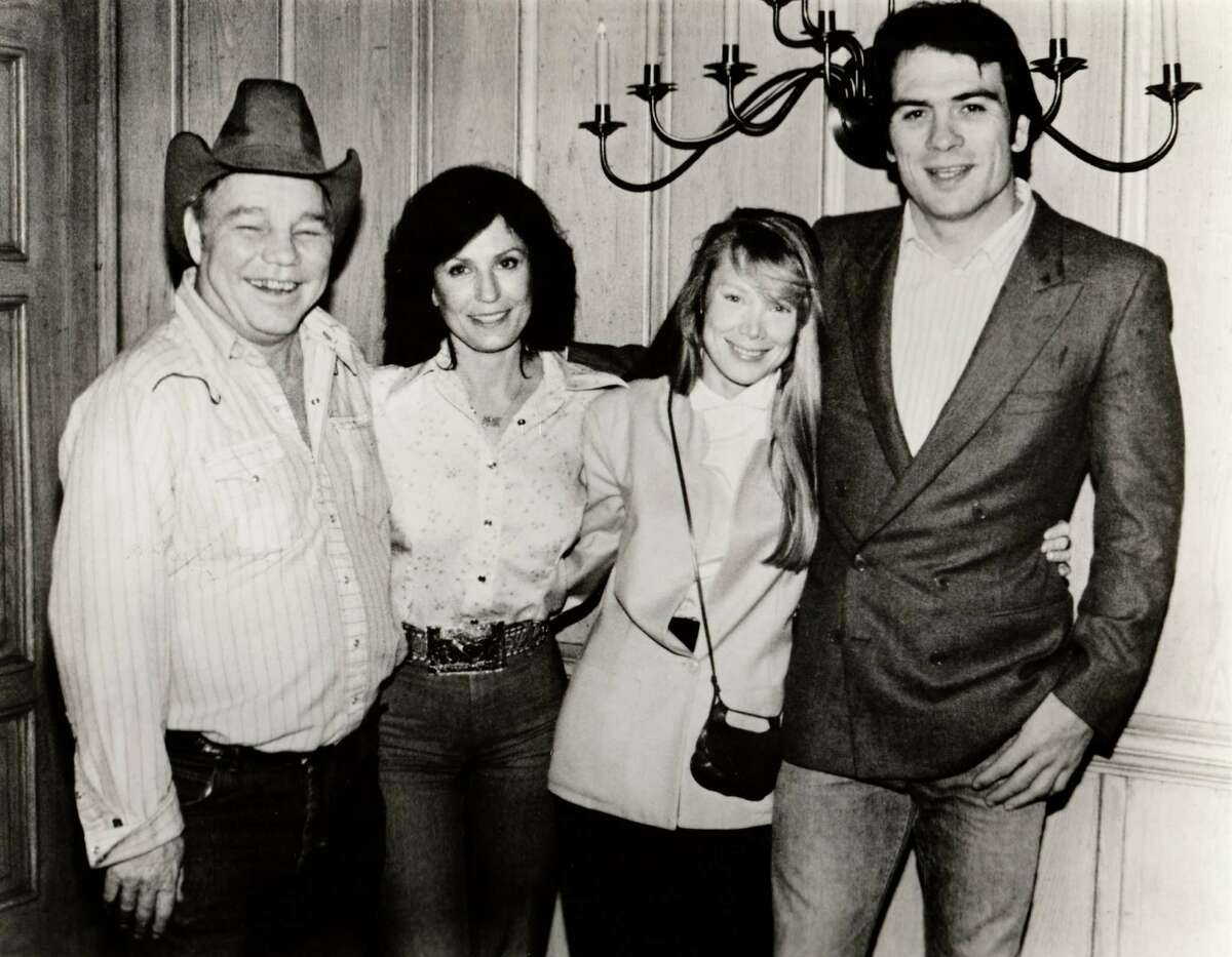 """Doolittle (left) and Loretta Lynn with the actors who played them in the 1980 film """"Coal Miner's Daughter,"""" Sissy Spacek and Tommy Lee Jones."""