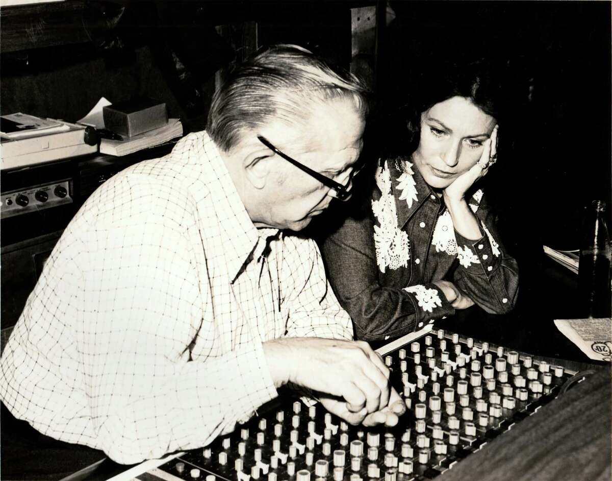 Loretta Lynn and Decca's Owen Bradley at the sound board in an undated photo.
