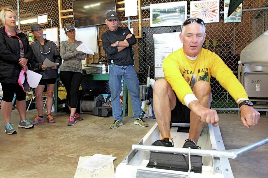 Jere Crean of Richmond, athletic director of the Greater Houston Rowing Club, uses a dock box simulator to teach students how to row a boat at a Saturday morning class at the club's boathouse in Sugar Land. Photo: Suzanne Rehak /For The Chronicle