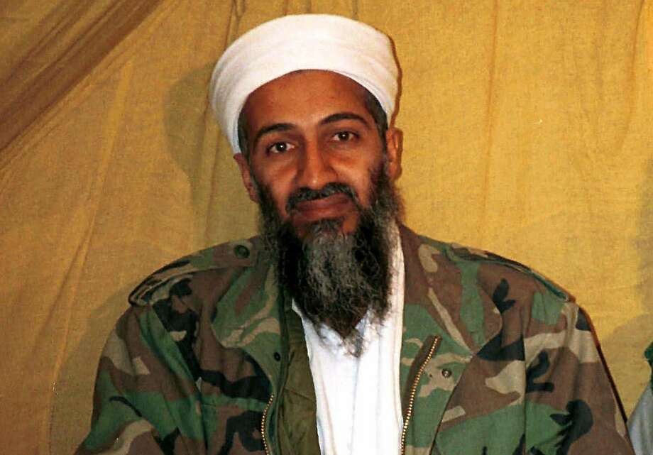 """FILE - In this undated file photo Osama bin Laden is seen in Afghanistan. In his last will and testament, bin Laden claimed he had about $29 million in personal wealth, the bulk of which he wanted to be used """"on jihad, for the sake of Allah."""" The will was released Tuesday, March 1, 2016, in a batch of more than 100 documents seized in a May 2011 raid that killed bin Laden at his compound in Abbottabad, Pakistan.  (AP Photo) Photo: Uncredited, Associated Press"""