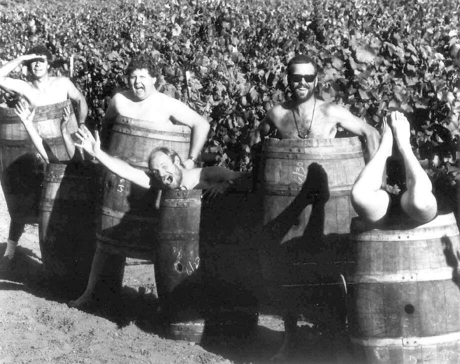 Ravenswood Winery winemakers Thijs Van Stigt (left), John Kemble, Joel Peterson, Clyde Crawford and Reed Foster Jr. (legs only) in the early years of the winery. Credit: Courtesy Ravenswood Winery