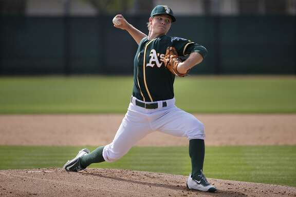 Sonny Gray 54 throws during the Oakland Athletics spring training workouts on Monday February 29, 2016, in Mesa, Arizona.