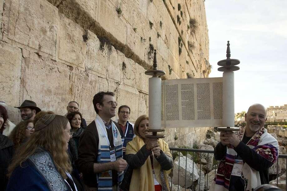 American Reform Rabbi Zachary Shapiro (center left) and other American and Israeli Reform rabbis pray at the Western Wall, the holiest site where Jews can pray in Jerusalem's Old City. Photo: Sebastian Scheiner, Associated Press