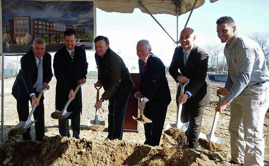 The dirt flew Tuesday marking the ceremonial groundbreaking for a new mixed-use development on Commerce Drive, that includes retail space and residential apartments. The development of the former Fitness Edge property is expected to be completed in the spring of 2017. Photo: Genevieve Reilly / Hearst Connecticut Media / Fairfield Citizen