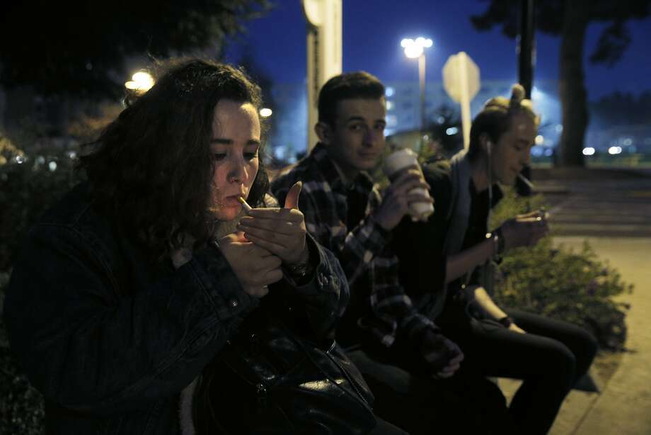 Natalie Richards, 19, smokes a cigarette as she sits with her friends Ben Rose, center, and Chase Melich, right, in a Designated Smoking Area at San Francisco State University as supervisors consider a plan to raise the purchasing age for tobacco products to 21 in San Francisco, Calif., on Monday, February 29, 2016. Photo: Carlos Avila Gonzalez, The Chronicle
