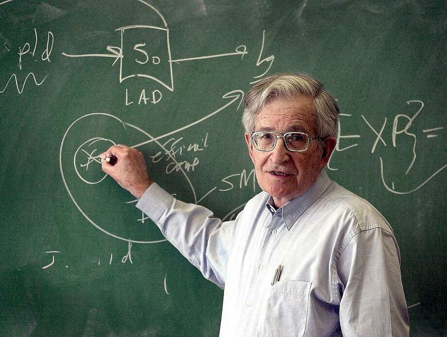 """Noam Chomsky, noted leftist thinker who explains in """"Requiem"""" why the American dream died, here discusses a linguistics theory at a high school in Portmsouth, N.H., in 2001. Photo: Rich Beauchesne, AP"""
