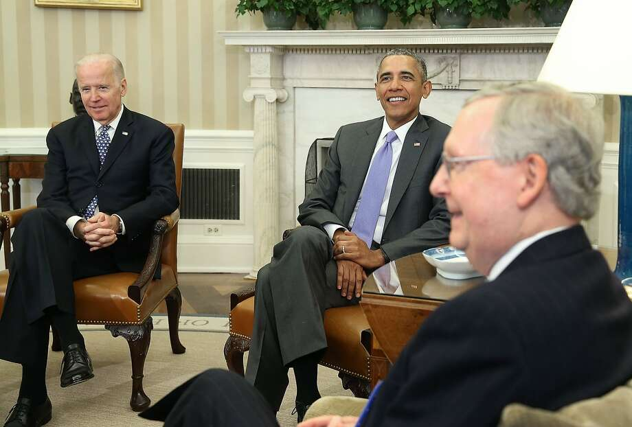 President Obama and Vice President Joe Biden discuss the court vacancy with Mitch McConnell and other senators. Photo: Mark Wilson, Getty Images