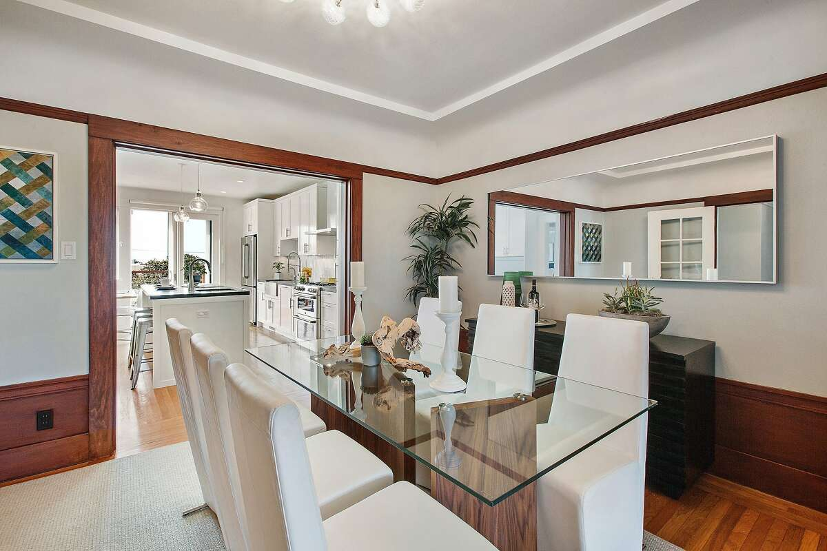 The formal dining room offers a raised ceiling and hardwood molding.