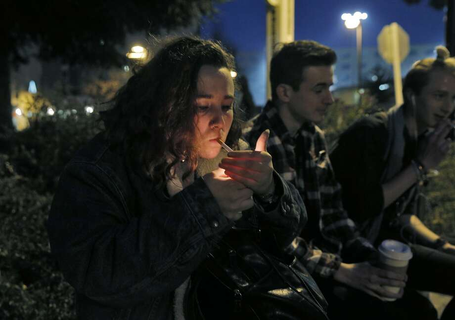 Natalie Richards, 19, smokes a cigarette in a Designated Smoking Area at San Francisco State University as supervisors consider a plan to raise the purchasing age for tobacco products to 21 in San Francisco, Calif., on Monday, February 29, 2016. Photo: Carlos Avila Gonzalez, The Chronicle