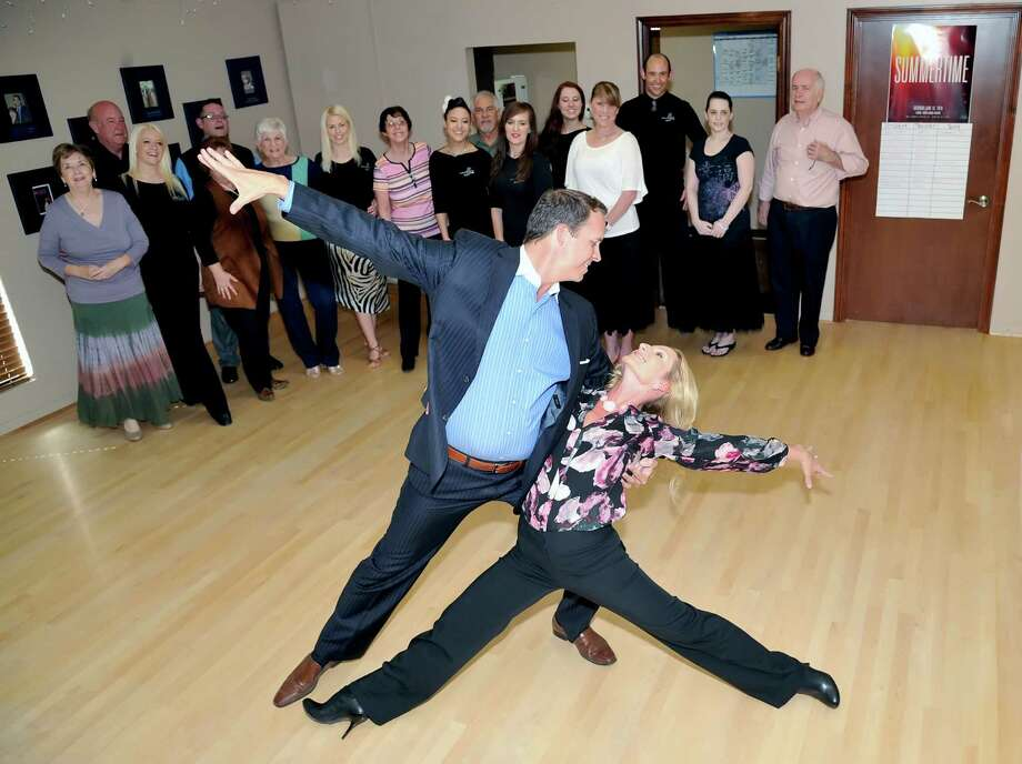 Hunter and Maria Johnson, owners of Arthur Murray dance studio in Cypress, show their students how it is done. Photo: Eddy Matchette, Freelance / Freelance