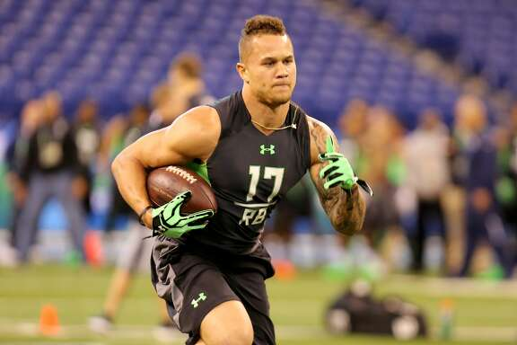 California running back Daniel Lasco during a drill at the NFL football scouting combine Friday, Feb. 26, 2016, in Indianapolis. (AP Photo/Gregory Payan)