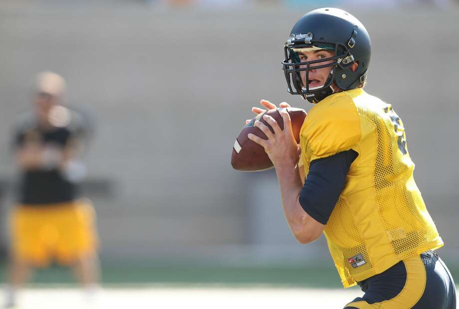 Cal quarterback Zach Kline practices at Memorial Stadium in Berkeley, Calif., on Saturday, August 17, 2013. Photo: Mathew Sumner, Special To The Chronicle