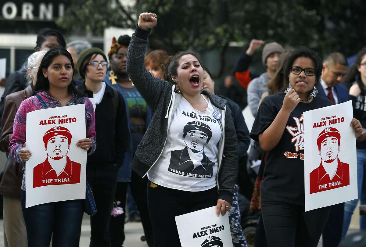 Violeta Vasquez (center) joins other supporters to demand justice for Alex Nieto during a rally at the Phillip Burton Federal Building in San Francisco, Calif. on Tuesday, March 1, 2016. Jury selection and opening arguments were scheduled to get underway Tuesday in a federal civil rights trial against four police officers who shot and killed Alex Nieto in Bernal Heights Park nearly two years ago.