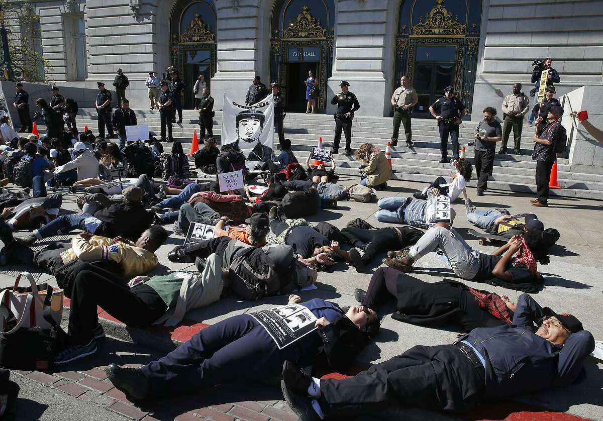 Protesters demanding justice for Alex Nieto stage a die-in in front of City Hall in San Francisco, Calif. on Tuesday, March 1, 2016. Jury selection and opening arguments were scheduled to get underway Tuesday in a federal civil rights trial against four police officers who shot and killed Alex Nieto in Bernal Heights Park nearly two years ago.