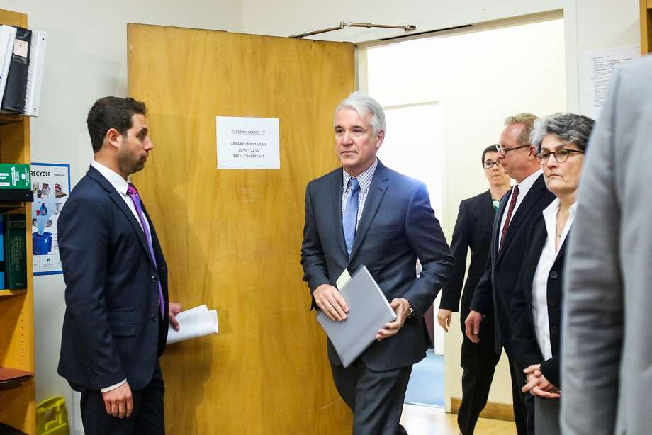 District Attorney George Gascon (center) makes his way to a press conference where he will announce the filing of a felony and misdemeanor charges against three former and one current deputy, in San Francisco, California, on Tuesday, March 1, 2016. Photo: Gabrielle Lurie, Special To The Chronicle