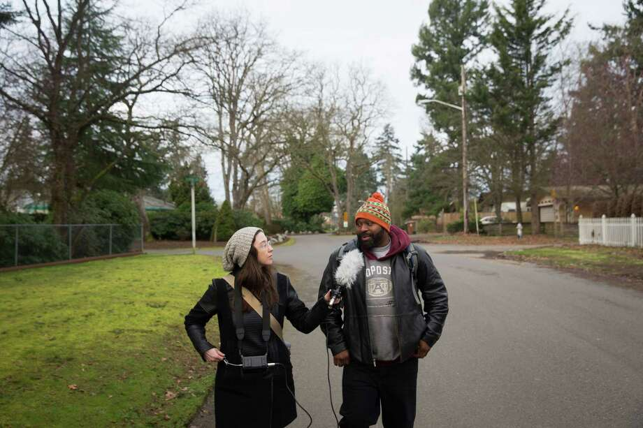 Al Brown talks to KBCS reporter Whitney Henry-Lester while walking to catch the bus to Evergreen State College-Tacoma, Wednesday, Feb. 24, 2016. Photo: GRANT HINDSLEY, SEATTLEPI.COM / SEATTLEPI.COM