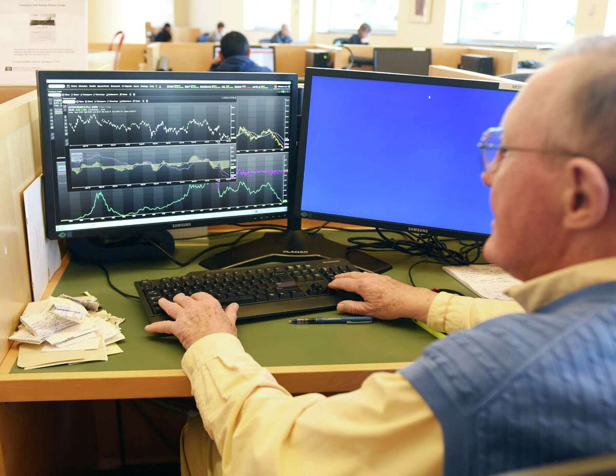Kenneth Clements, of Greenwich, uses the new Money.Net terminal at Greenwich Library in Greenwich, Conn. Tuesday, March 1, 2016. Money.Net is a new competitor to the well-known Bloomberg Terminal that allows users to monitor and analyze markets with real-time data.