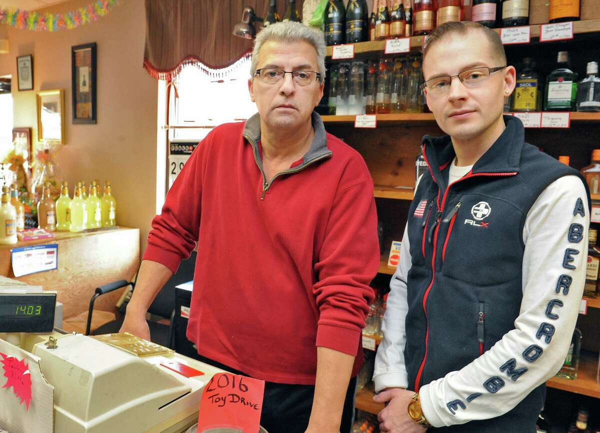 Co-owners of Bob DeMeo's Discount Wine and Liquor store Bob DeMeo, left, and Anthony DeRusso DeMeo in the store Tuesday March 1, 2016 in Troy, NY. They were held up at gun-point.. (John Carl D'Annibale / Times Union)