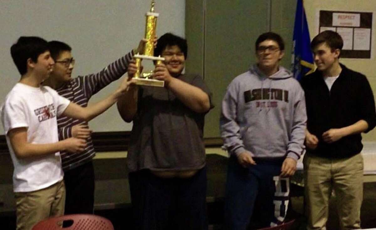From left, Greenwich High chess club members Robby Blank, Jason Shi, Zachary Chen Tanenbaum, Kevin Jordan and Will DeTeso celebrate their title at the state chess championship on Saturday, Feb. 27, 2016 in East Hartford.