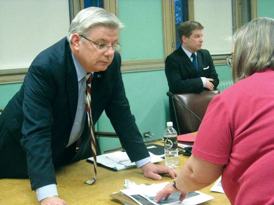 Department of Public Utility Control Commissioner John Betkowski hears an area resident's concerns about CL&P's response to days-long outages following the torrential storm on March 13 and 14 at a public hearing in New Canaan on April 7. Photo: Brittany Lyte / New Canaan News