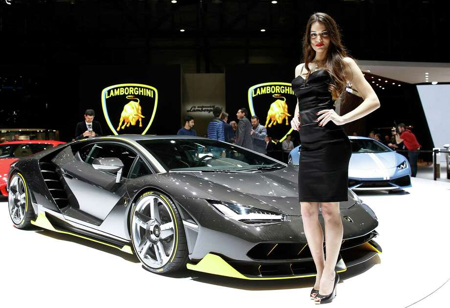A Model Poses Next To A Lamborghini Centenario Model During The First Press  Day Of The
