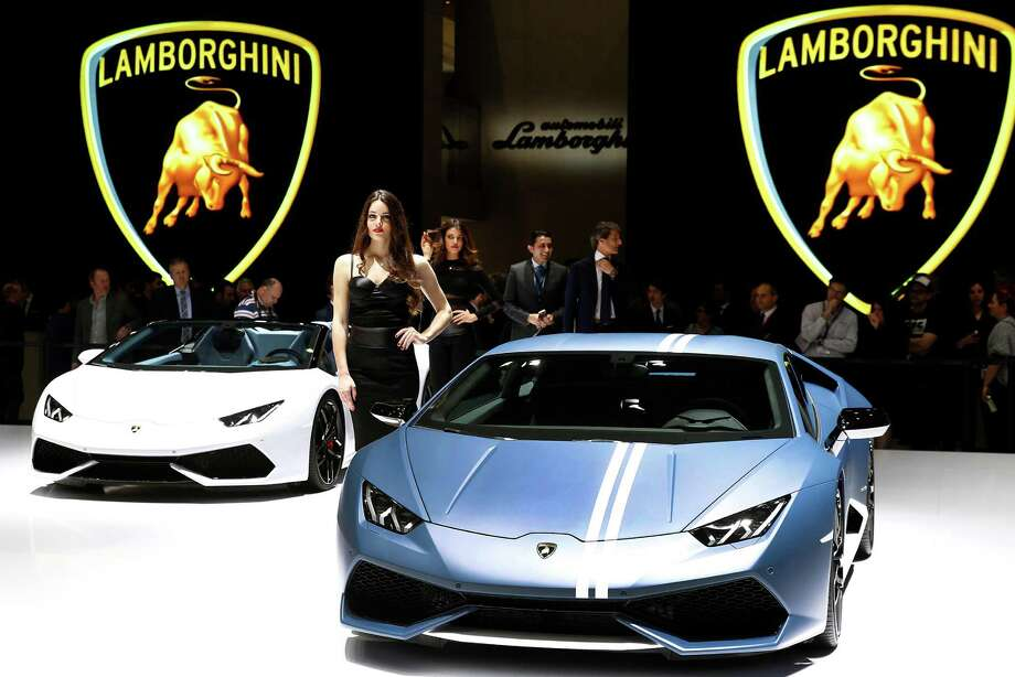 FILE: A model poses next to a Lamborghini Huracan model during the first press day of the 86th Geneva International Motor Show on March 1, 2016 in Geneva, Switzerland. Photo: Chesnot, Getty Images / 2016 Chesnot