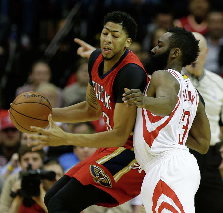 New Orleans Pelicans forward Anthony Davis (23) is guarded by Houston Rockets guard James Harden (13) during first half of NBA game Wednesday, Dec. 2, 2015, in Houston. Photo: Melissa Phillip, Houston Chronicle / © 2015 Houston Chronicle