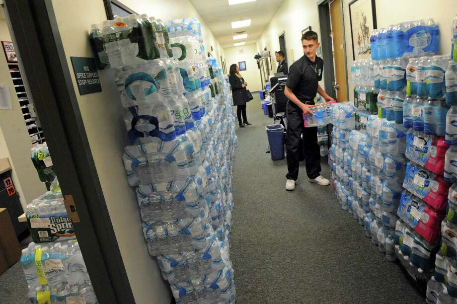Ninth grade student Dylan Meyers stacks donated bottled water to be sent to Flint, Michigan at Green Tech High Charter School on Tuesday March 1, 2016 in Albany, N.Y. Dylan's family donated 80 cases of water. (Michael P. Farrell/Times Union) Photo: Michael P. Farrell / 10035634A