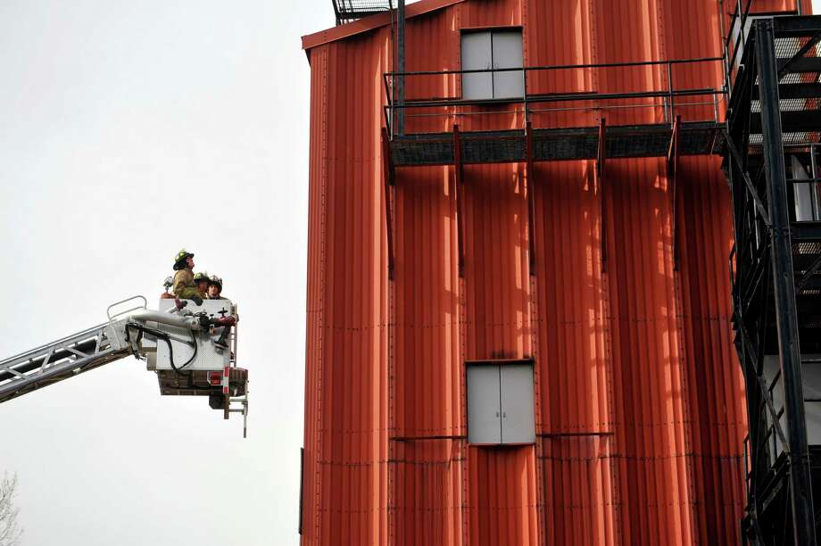 A firefighter works with two recruits in a bucket ladder truck  during firefighter training for recruits from Albany, Troy and Watervliet Fire Departments at the Colonie Fire Training Center on Tuesday, March 1, 2016, in Colonie, N.Y.  Recruits were learning how to operate and safely deploy the equipment.     (Paul Buckowski / Times Union) Photo: PAUL BUCKOWSKI / 10035619A