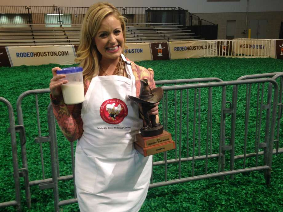 Maggie Flecknoe, morning anchor for CW39, shows off the championship trophy she won at the Celebrity dairy goat milking contest. Photo: Andrea C. Rumbaugh