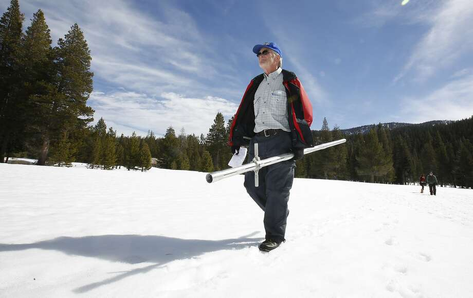 Frank Gehrke, chief of the California Cooperative Snow Surveys Program for the Department of Water Resources, leaves the snow covered meadow after conducting the third manual snow survey of the season at Phillips Station near Echo Summit, Calif., Tuesday, March 1, 2016.  State surveyors found Tuesday that a record-breaking warm, dry month of February ate away at what had been a well-above normal Sierra Nevada snowpack. (AP Photo/Rich Pedroncelli) Photo: Rich Pedroncelli, AP