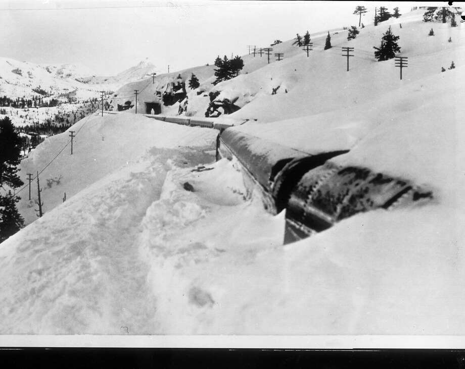 "Snowdrifts on top of the stuck ""City of San Francisco"" train in January 1952. Photo: Ken McLaughlin, The Chronicle"