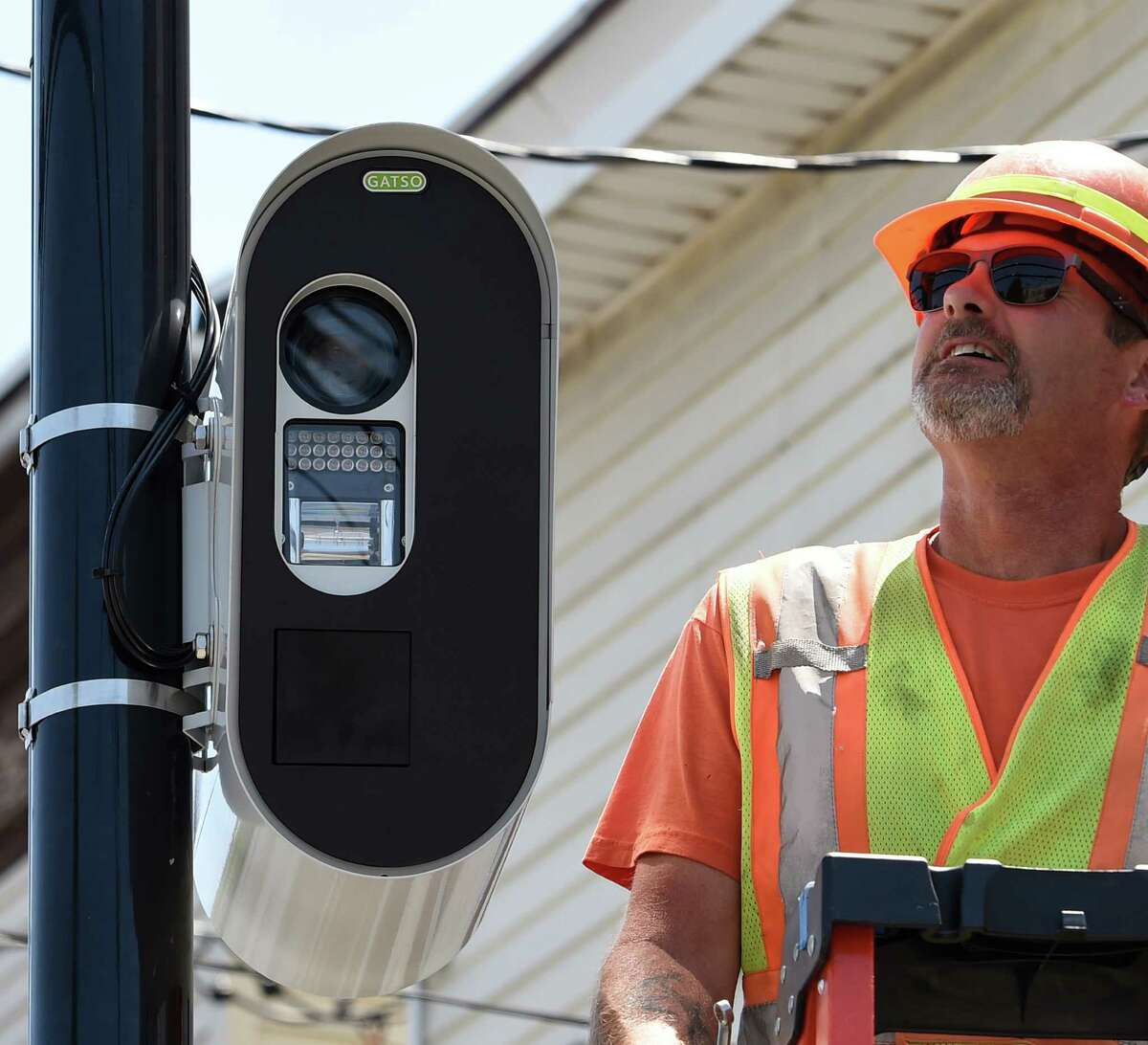Jeff Smith of the Stilsing Company puts the finishing touches on a red-light camera that looks in to the intersection of Quail Street and Washington Avenue Thursday afternoon July 16, 2015 in Albany, N.Y. (Skip Dickstein/Times Union archive)