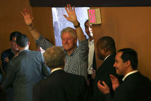 Former President Bill Clinton, followed by Congressman Joaquin Castro, far right, waves to supporters as they  leave the Hillary for Texas Get Out The Vote Rally at the Guadalupe Cultural Arts Center Theater in San Antonio on Monday, Feb. 29, 2016.