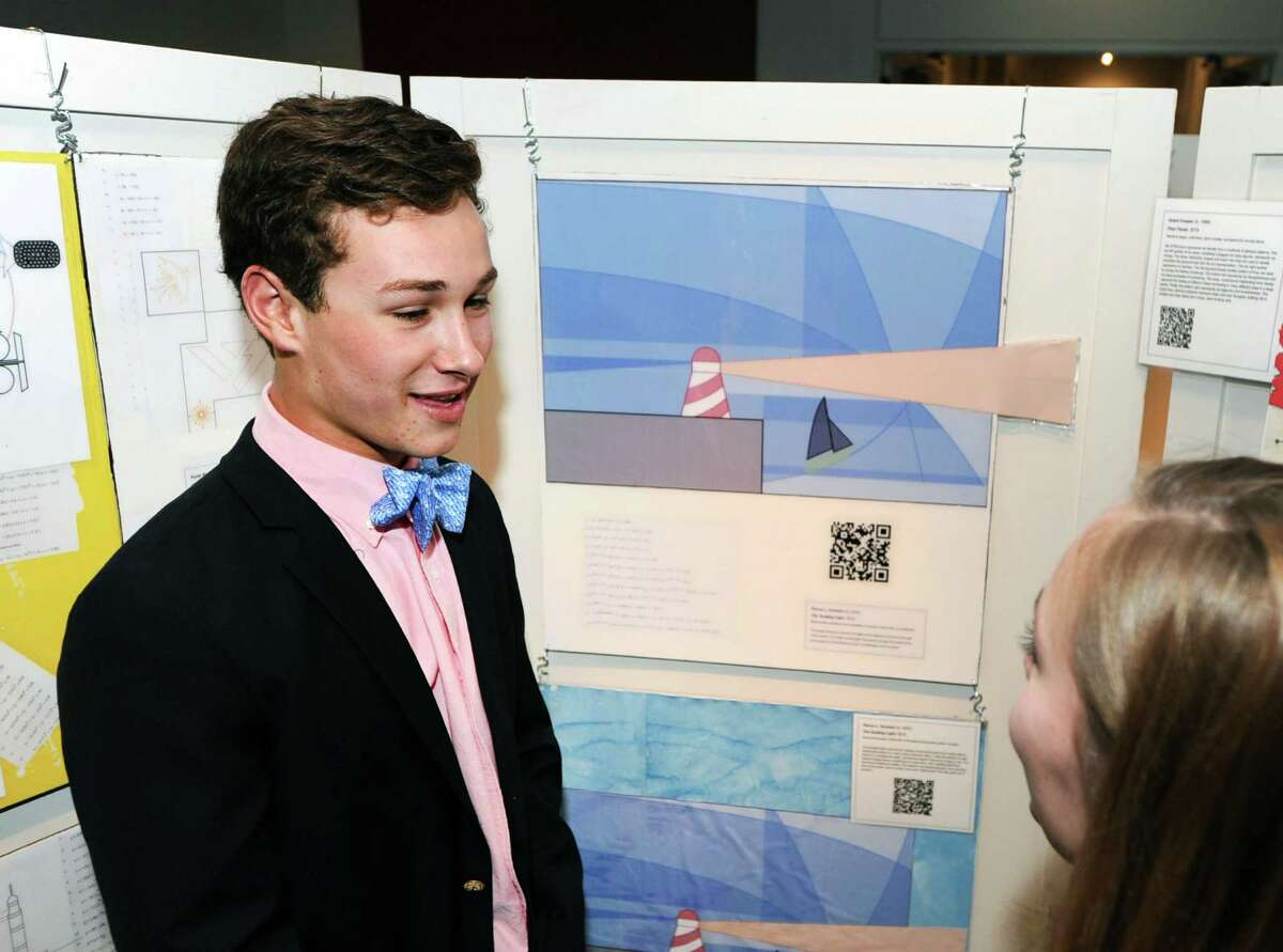 Greenwich High School sophomore Pierce Ornstein, 15, left, explains his artwork of a lighthouse that he made using a mathematical formula, a graphing calculator and a computer during an exhibition of the Humanities and Modernism projects created by Greenwich High School sophomores who are members of the Innovation Lab program at the Bruce Museum in Greenwich, Conn., Tuesday night, Feb. 2, 2016. According to Julie Faryniarz, executive director of the Greenwich Alliance for Education, research and development for the GHS Innovation Lab was funded through a grant provided by the Greenwich Alliance Reaching Out Grants program.