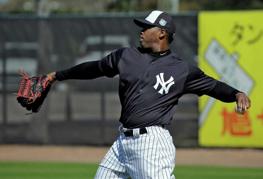 FILE - In this Feb. 19, 2016, file photo, New York Yankees pitcher Aroldis Chapman throws during a spring training baseball workout, in Tampa, Fla. Aroldis Chapman agreed to accept a 30-game suspension under Major League Baseball's domestic violence policy, a penalty stemming from an incident with his girlfriend last October.  Under the discipline announced Tuesday, March 1, 2016, Chapman will serve the penalty from the start of the season in April.(AP Photo/Chris O'Meara) ORG XMIT: NY184 Photo: Chris O'Meara / AP