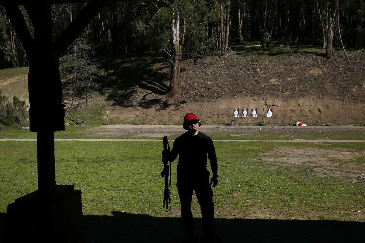 Police officer and firearms instructor Mike Lee holds an AR-15 during an Emeryville Police Department annual firearms training at the Chabot Gun Club March 1, 2016 in Castro Valley, Calif. The East Bay Regional Park District Board of Directors was considering whether or not to close Chabot Gun Club, the gun range in Chabot Regional Park due to concerns about lead and noise issues.