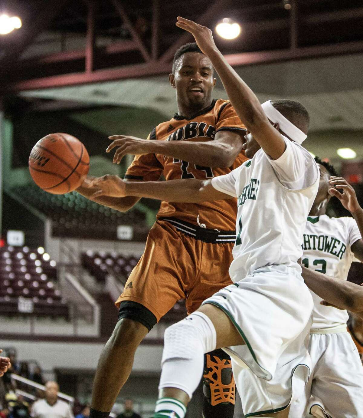 Jason Lester of Dobie grabs a rebound during a game Tuesday March 1, 2016. Hightower played Dobie in a boys basketball playoff game at the Campbell Center.