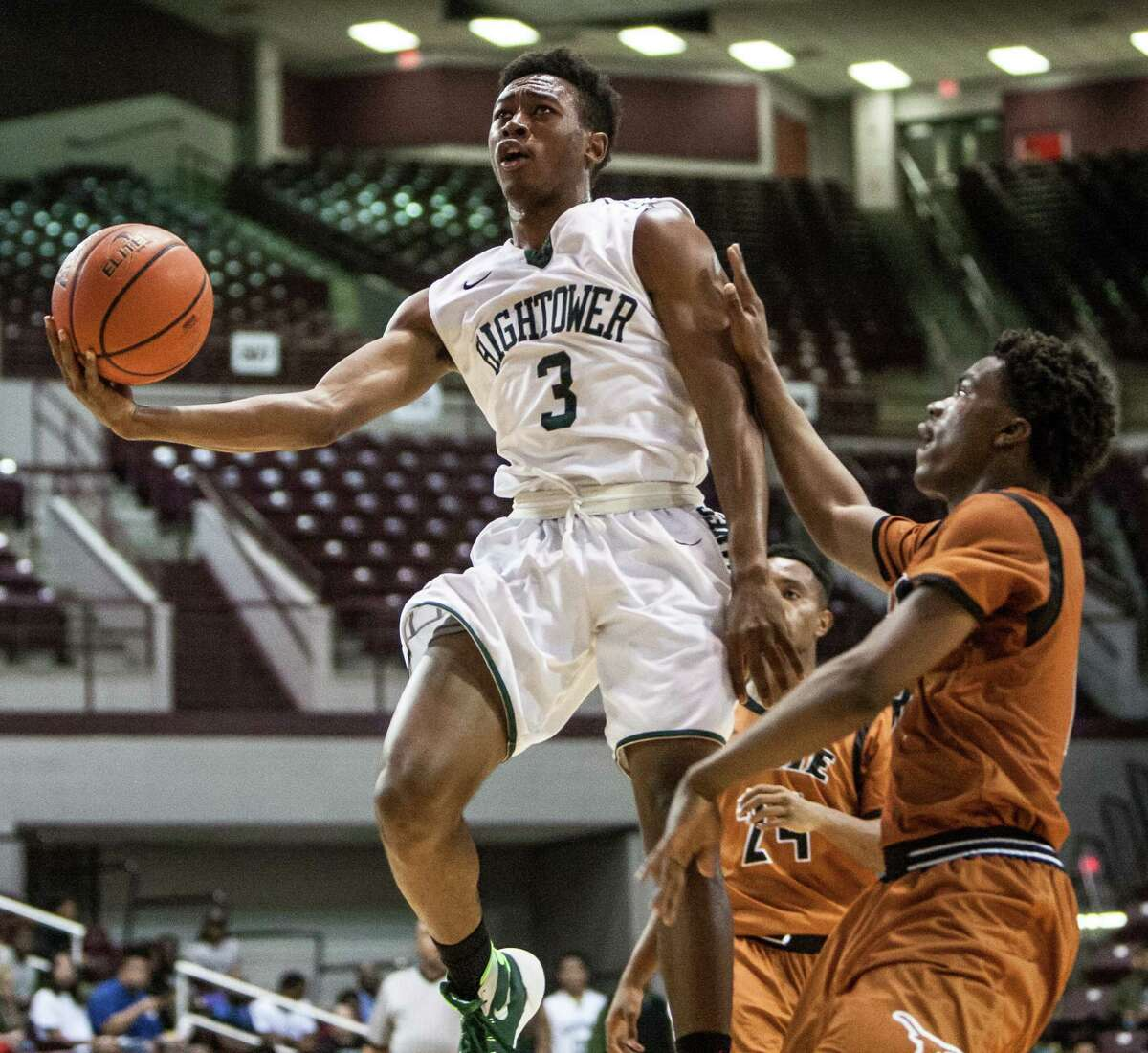 Kaelin Jackson of Hightower attempts a layup during a game Tuesday March 1, 2016. Hightower played Dobie in a boys basketball playoff game at the Campbell Center.